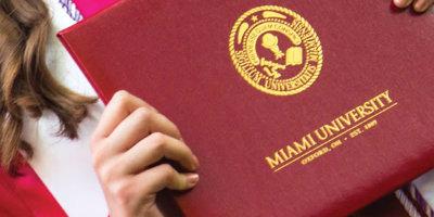 Graduate holding Miami University diploma cover