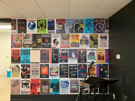 A wall with book covers inside The Fringe Coffee House