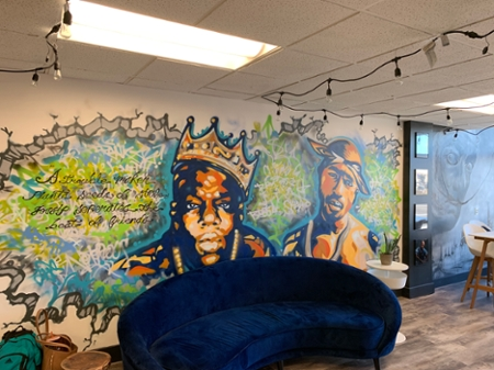 A hand painted wall inside The Fringe Coffee House with 2 men wearing crowns.