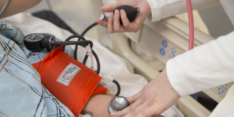 Nursing student taking vitals