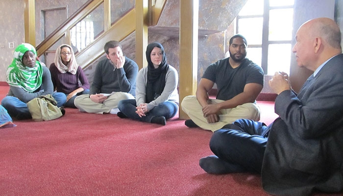 SBS students sitting on the floor during their visit to the Islamic Center of Greater Cincinnati.