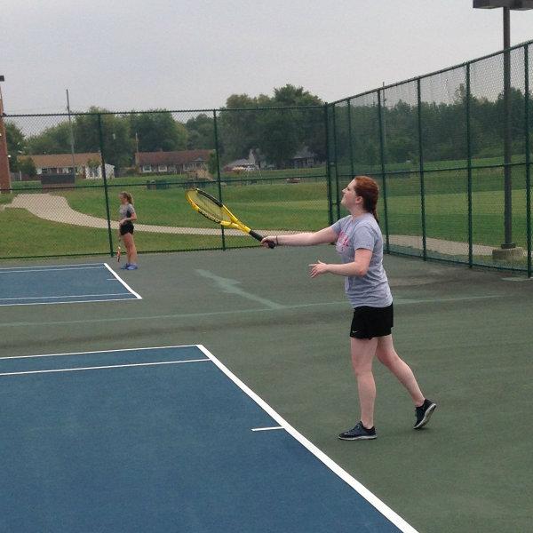 Women's Tennis Athlete Serving
