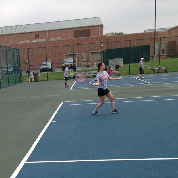 Women's tennis athlete returning volley