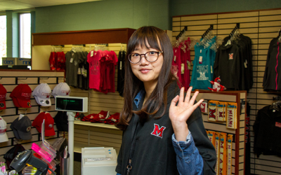 student wearing Miami gear in Regional bookstore