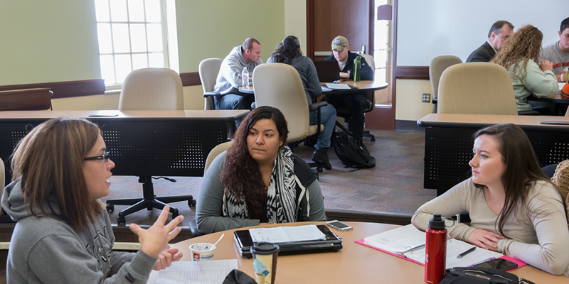 JCS students in small group discussions at VOALC