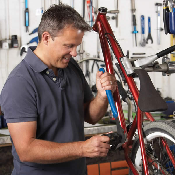 Small business owner working in his cycle shop