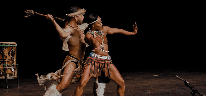 The dance group step Africa on the stage of Dave Finkelman Auditorium.