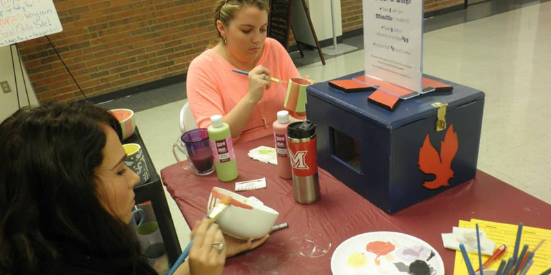 Students participating in a craft activity