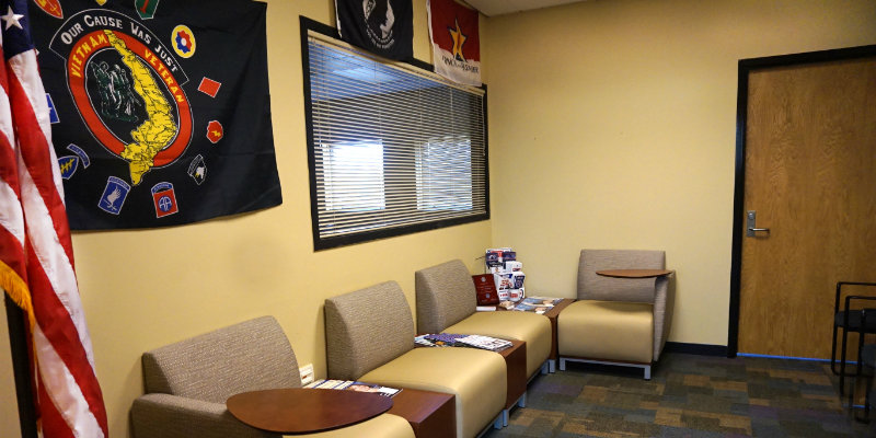 MUH Veterans Services Lobby with chairs, table, and flags