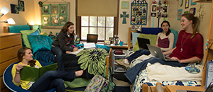 women in residence hall room