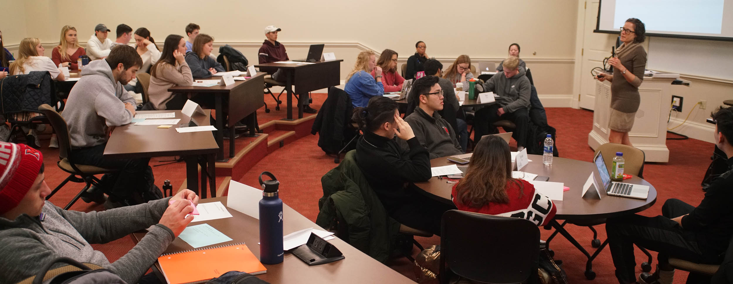 Wide photo of Brenda Homan teaching an accounting class